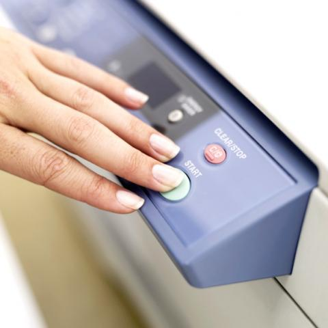 Womans Hand by Photocopier